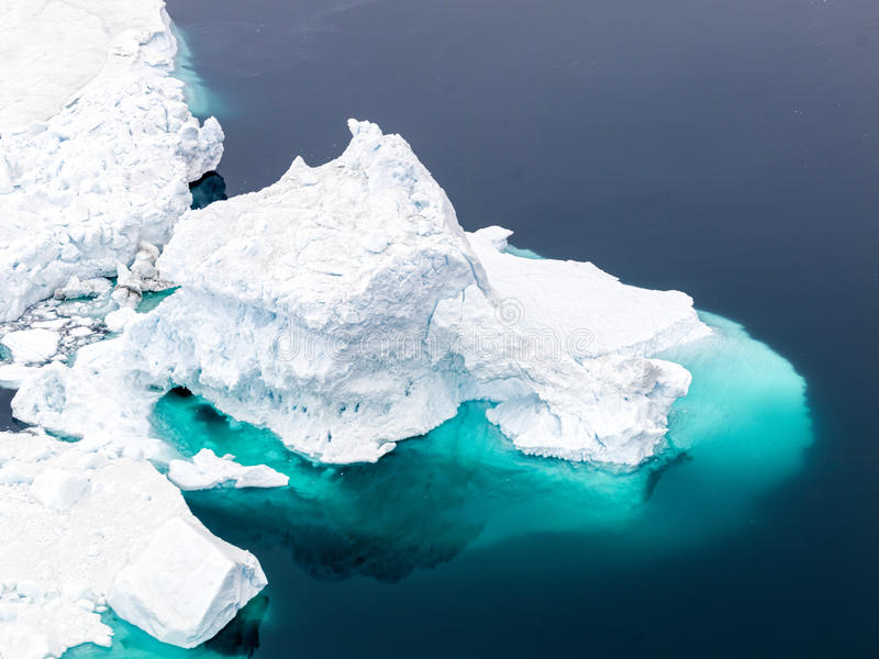 Aerial view of the icebergs on arctic ocean at Greenland royalty free stock photography