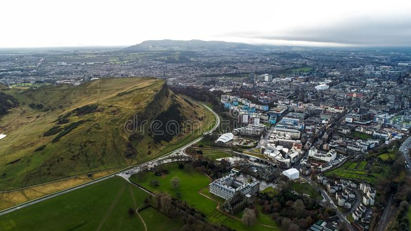 Aerial View Iconic Landmarks Arthur`s Seat Hill in Edinburgh Scotland UK. Aerial View Flying Over Iconic Landmarks in Edinburgh Famous Arthur`s Seat Hill, Modern royalty free stock image