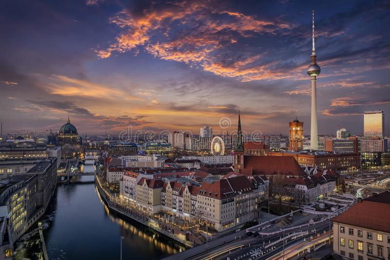 Aerial view of the illuminated Berlin skyline and Spree river during beautiful sunset royalty free stock photography