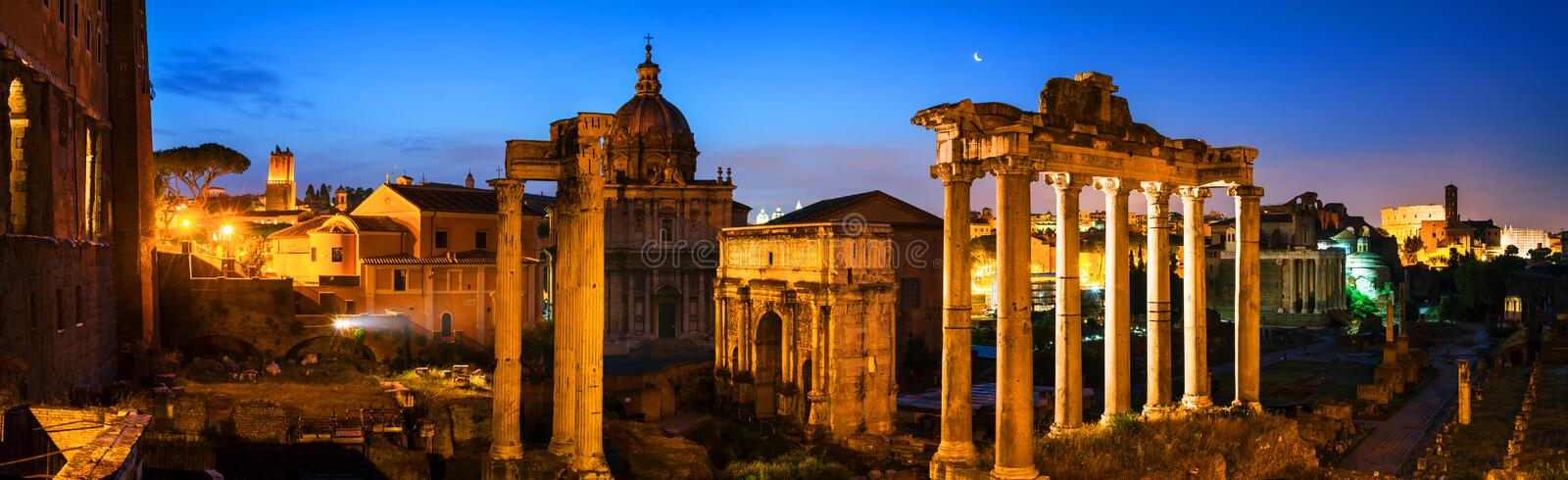 Aerial view of illuminated Roman forum in Rome, Italy at night royalty free stock photo