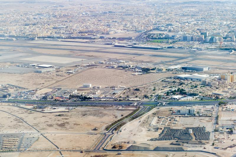 Aerial view at increase of Doha city. Ras Abu Abboud Expy road, F Ring section stock images