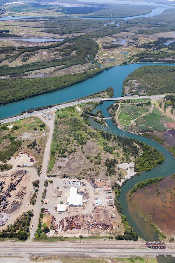 Industrial area adjacent to Kooragang Wetlands - Newcastle NSW Australia. Aerial view of industrial area and wetlands at Kooragang - Newcastle NSW Australia stock photography
