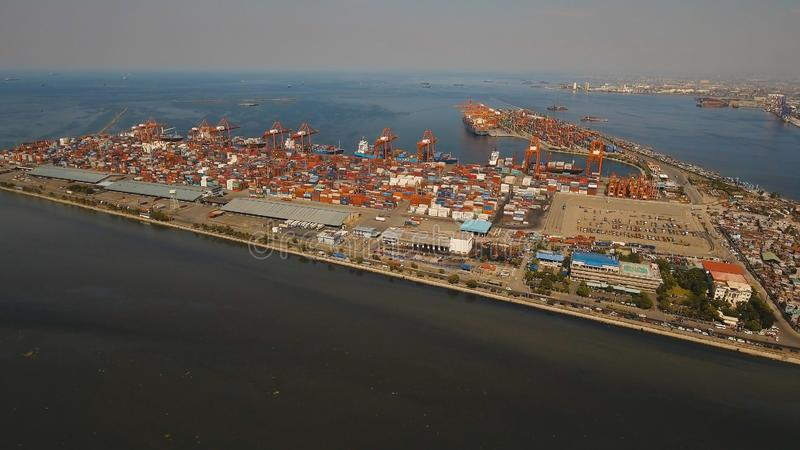 Cargo industrial port aerial view. Manila, Philippines. Aerial view industrial cargo port with ships and cranes, Manila. View of the cargo port and container stock image