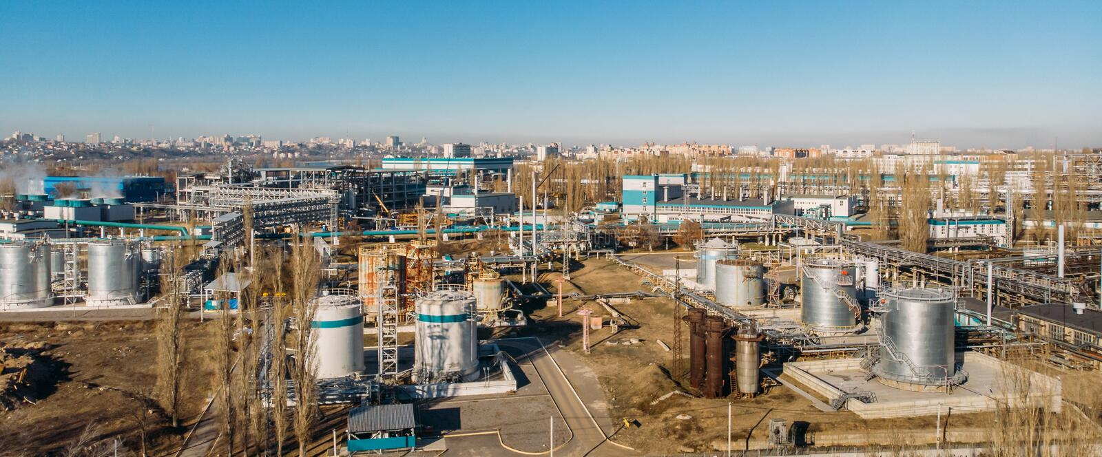 Aerial view of industrial factory or plant buildings with steel storage construction tanks and pipes royalty free stock images