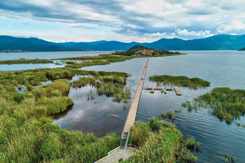Aerial view of island of Agios Achilios in lake Small Prespes. Northern Greece royalty free stock photo