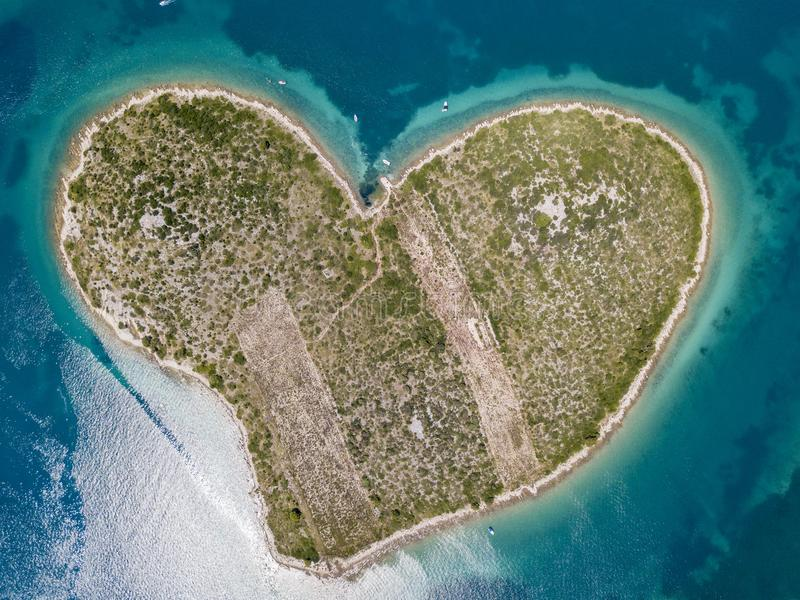 Aerial view of the island in the shape of a heart, Croatia, island of lovers, Otok Galesnnjak, islet, rock. Also called otok za Za royalty free stock images