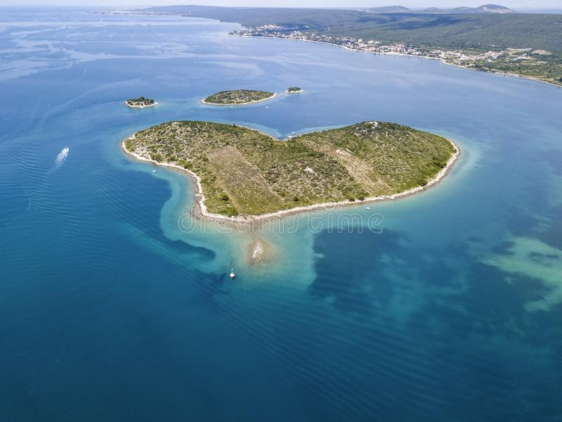 Aerial view of the island in the shape of a heart, Croatia, island of lovers, Otok Galesnnjak, islet, rock. Also called otok za Za stock photography