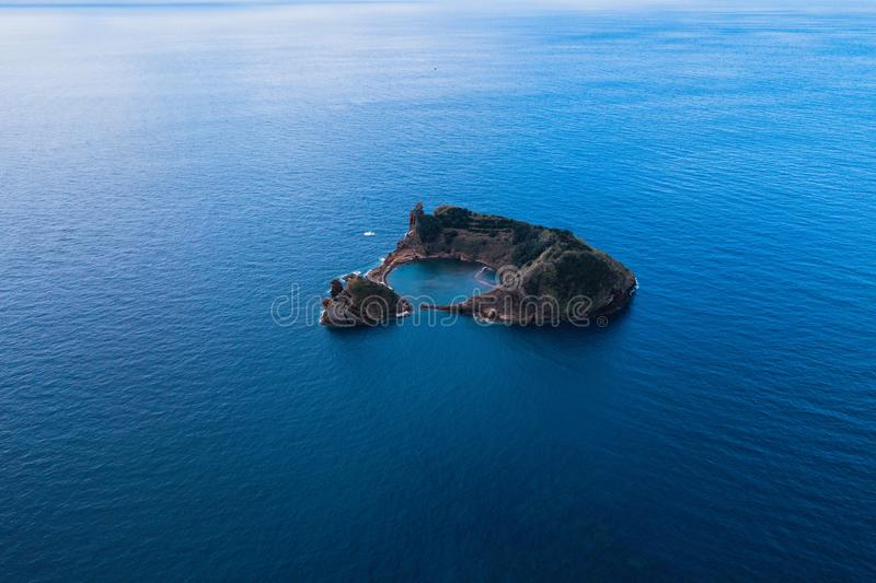 Aerial view of the Islet of Vila Franca do Campo near San Miguel island, is formed by the crater of an old underwater volcano. royalty free stock photo