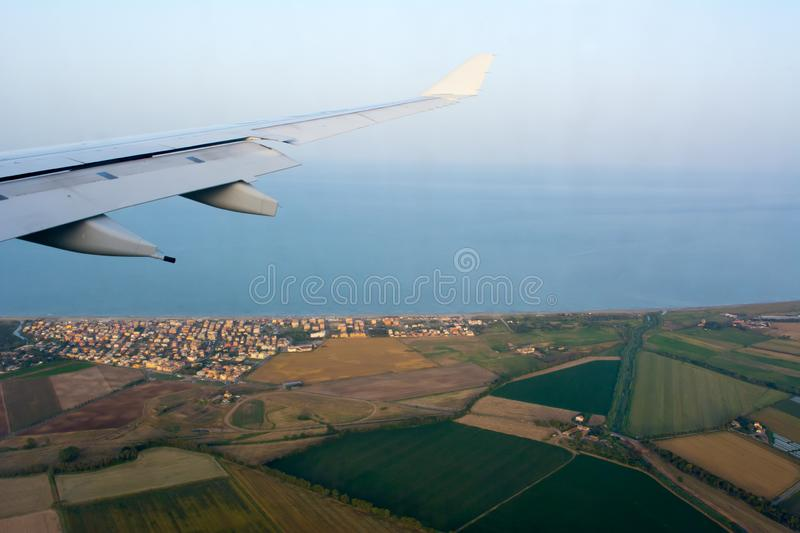 Aerial View of Italian Plantation Landscape in Tuscany taken from an Airplane in Flight on Blur Background. Aerial View of Italian Plantation Landscape in royalty free stock image