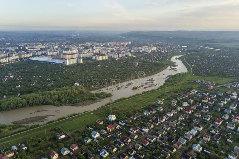 Aerial view of Ivano-Frankivsk city with residential area and suburb houses with a river in middle royalty free stock image