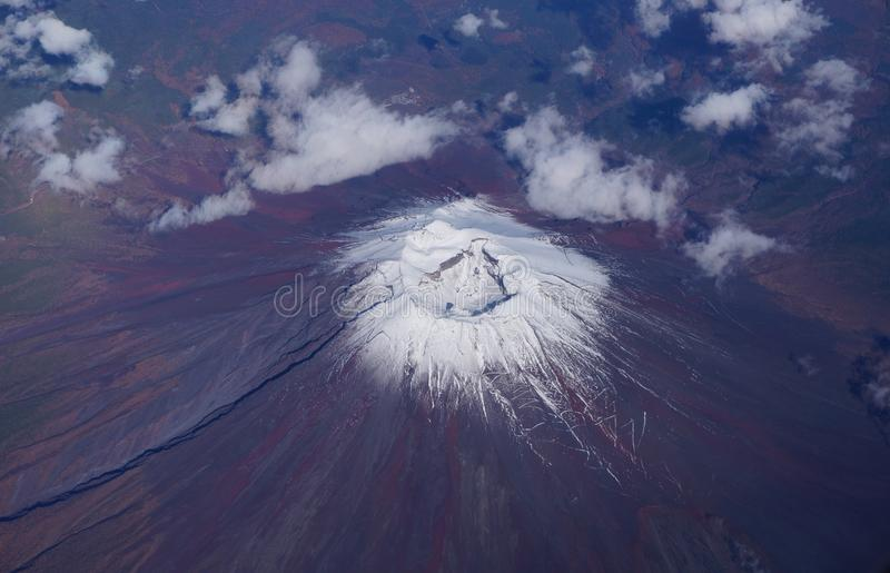 Aerial view of Japan's Mount Fuji volcano. Crater with a small snowcap royalty free stock image