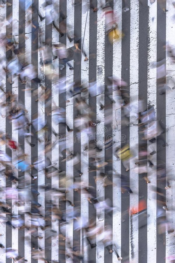 Aerial view of a japanese pedestrian passage in Tokyo painted with white stripes on the black asphalt used by the traffic of cars royalty free stock photography