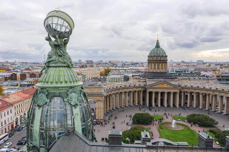 Aerial view of Kazan Cathedral in clear autumn day, a copper dome, gold cross, colomns, Nevsky prospect, Zinger`s Building,. Griboyedov Canal, staff apartments royalty free stock images