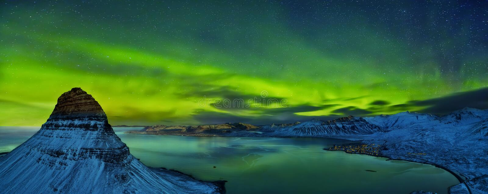 Aerial view of Kirkjufell mountain with beautiful aurora borealis in winter, Iceland. One of the famous natural heritage in Iceland stock images