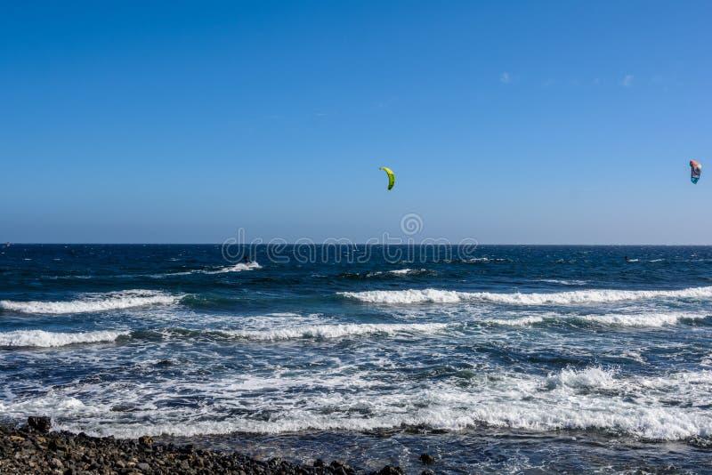 Aerial view of Kitesurfing on the waves of the sea. Kitesurfing, El Medano, Tenerife, Spain. Aerial view of Kitesurfing on the waves of the sea. Kitesurfing royalty free stock photos