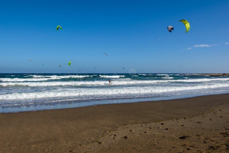 Aerial view of Kitesurfing on the waves of the sea. Kitesurfing, El Medano, Tenerife, Spain. Aerial view of Kitesurfing on the waves of the sea. Kitesurfing royalty free stock photography