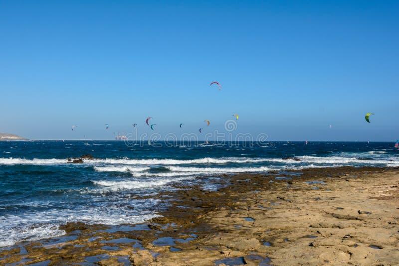 Aerial view of Kitesurfing on the waves of the sea. Kitesurfing, El Medano, Tenerife, Spain. Aerial view of Kitesurfing on the waves of the sea. Kitesurfing royalty free stock images