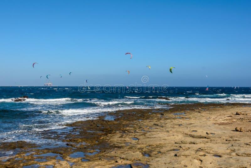 Aerial view of Kitesurfing on the waves of the sea. Kitesurfing, El Medano, Tenerife, Spain. Aerial view of Kitesurfing on the waves of the sea. Kitesurfing royalty free stock image