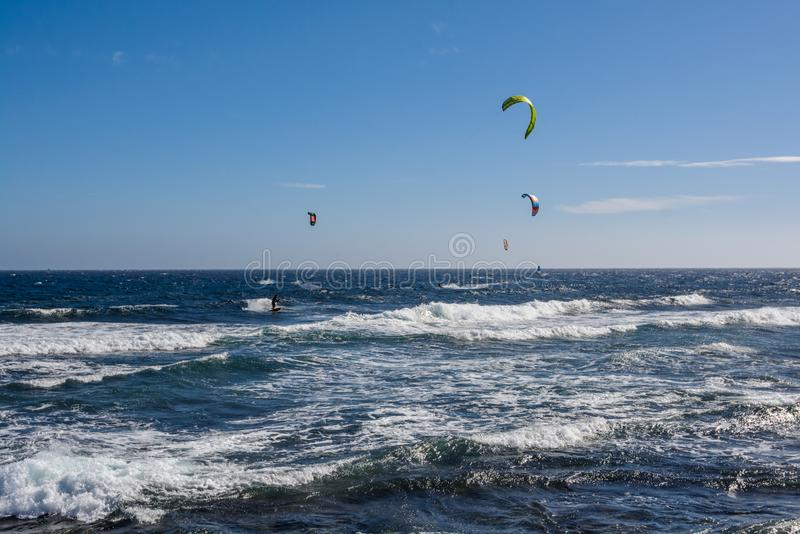 Aerial view of Kitesurfing on the waves of the sea. Kitesurfing, Kiteboarding action photos royalty free stock photography