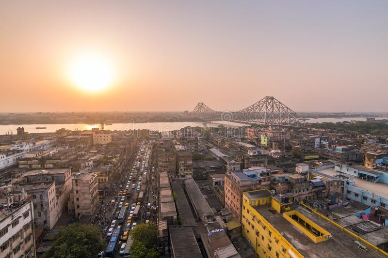 Aerial view of Kolkata city, India. Beautiful sunset over the famous Howrah bridge - The historic cantilever bridge on the river Hooghly, Calcutta, India royalty free stock photos
