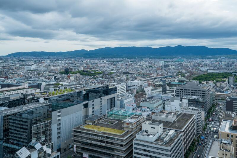 Aerial view of the Kyoto cityscapes during the twilight in a cloudy day, Japan.  stock images