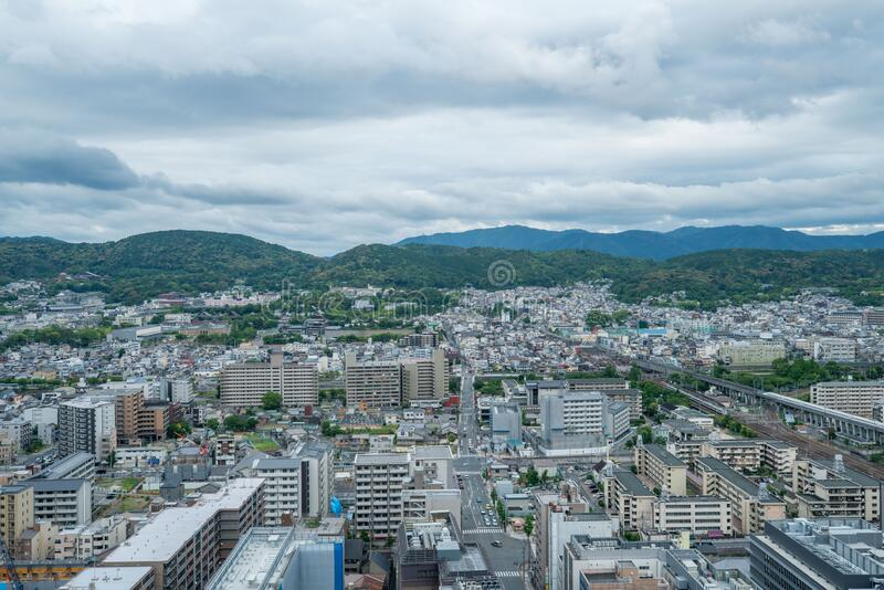 Aerial view of the Kyoto cityscapes during the twilight in a cloudy day, Japan.  royalty free stock photo