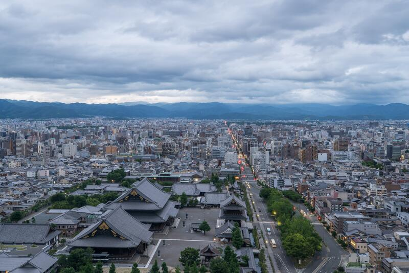 Aerial view of the Kyoto cityscapes during the twilight in a cloudy day, Japan.  royalty free stock images