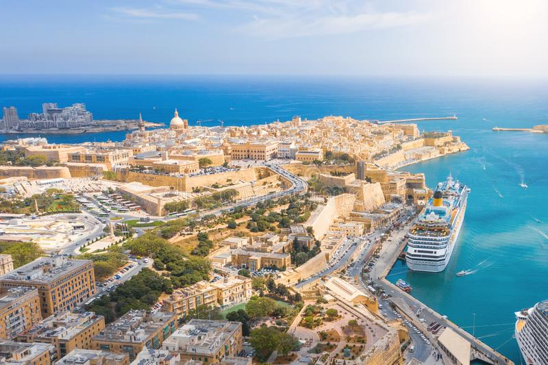 Aerial view of Lady of Mount Carmel church, St.Paul`s Cathedral and a great bay with a cruise liner ship in Valletta city, Malta royalty free stock photography