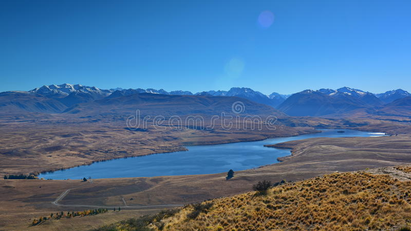 Aerial view of Lake Alexandrina, surrounded by mountain ranges in Canterbury royalty free stock image