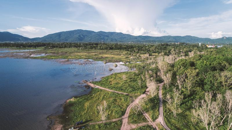 Aerial view of Lake along the forest by drone. Landscape and nature theme stock image