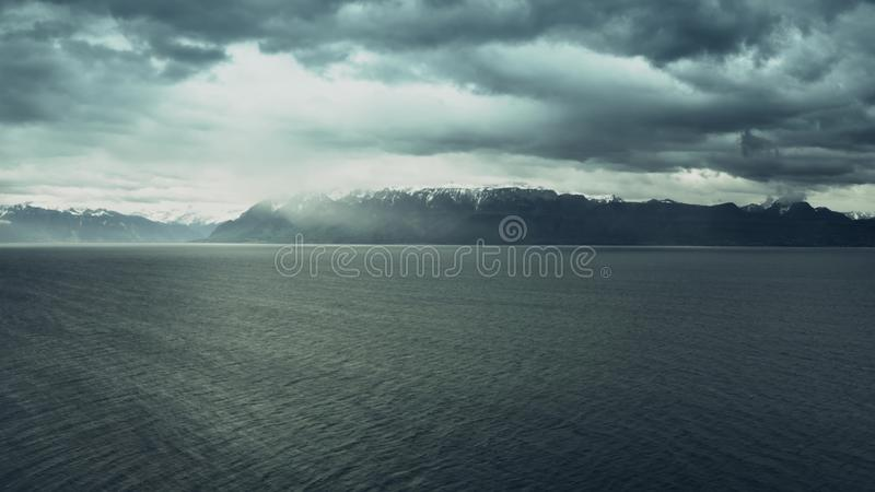 Aerial view of the Lake Geneva and the Alps on a stormy day, Switzerland stock image