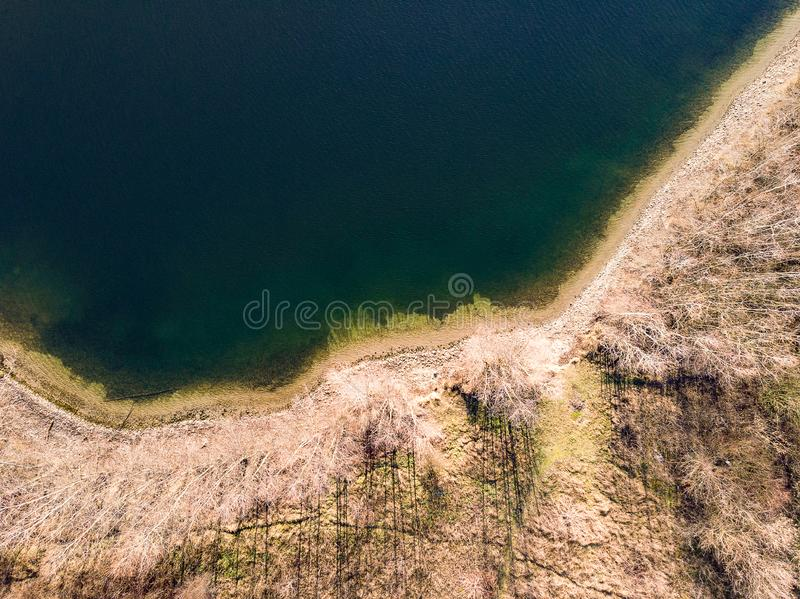 Aerial view of a lake shore in winter on a sunny day royalty free stock photo