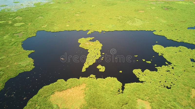 Aerial view of lake in Siem-Reap, Cambodia, with fisherman boat. Drone Aerial view of lake in Siem-Reap, Cambodia, with fisherman boat royalty free stock photos