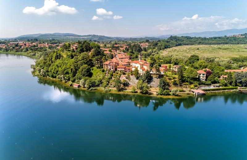 Aerial view of Lake Varese and church of San Lorenzo of Biandronno. stock image