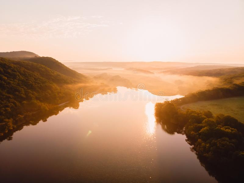 Aerial view of lake and warm sunset or sunrise royalty free stock photo
