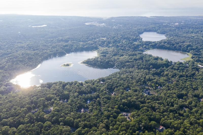 Aerial View of Lakes in Orleans, Cape Cod, Massachusetts. Seen from a bird`s eye view, sunlight reflects off the waters found in Orleans, Cape Cod, Massachusetts royalty free stock photography
