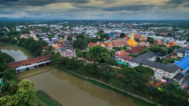 Aerial view lamphun city and People walking on lamphun walk street or night market. tourist attraction in lamphun royalty free stock image