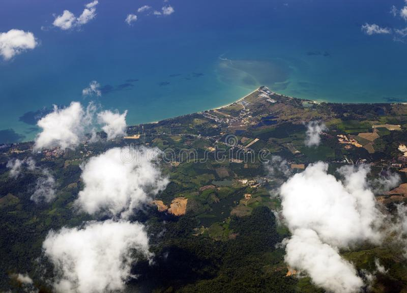 Aerial view of land and blue sea, Thailand. Aerial view of land and blue sea from airplane window. Thailand landscape, top view stock image