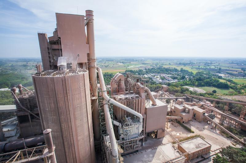 Aerial view, landscape of cement factory, village and paddy fields. Bright sunlight stock photos