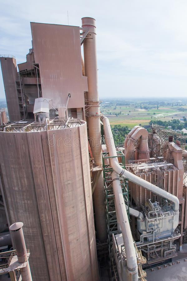 Aerial view, landscape of cement factory, village and paddy fields. Bright sunlight stock photo