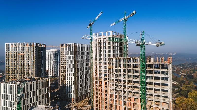 Aerial view of landscape in the city with under construction buildings and industrial cranes. Construction site. Aerial view of landscape in the city with under stock photography