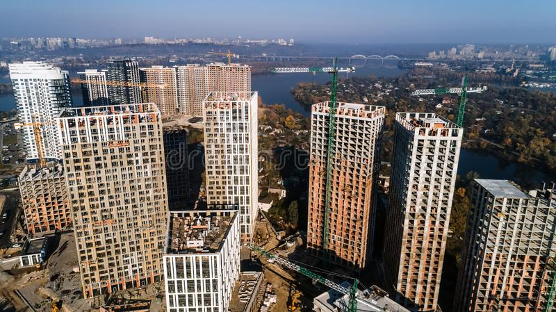 Aerial view of landscape in the city with under construction buildings and industrial cranes. Construction site. Aerial view of landscape in the city with under stock images