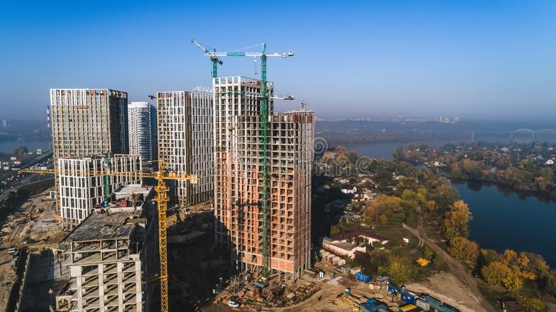 Aerial view of landscape in the city with under construction buildings and industrial cranes. Construction site. Aerial view of landscape in the city with under royalty free stock photography