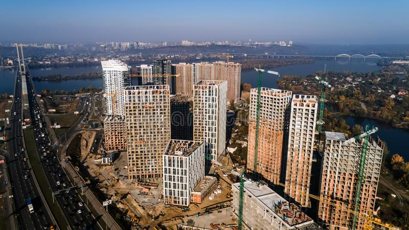 Aerial view of landscape in the city with under construction buildings and industrial cranes. Construction site. Aerial view of landscape in the city with under royalty free stock photos