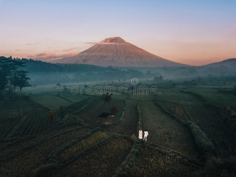 Aerial view of landscape Couple with Terrace rice field of Mount Agung volcano in Bali in Indonesia.  stock photography