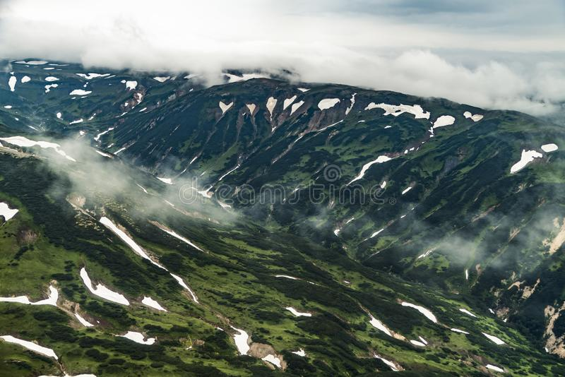 Aerial view of landscape with green plains on Kamchatka peninsula, Russia stock photos
