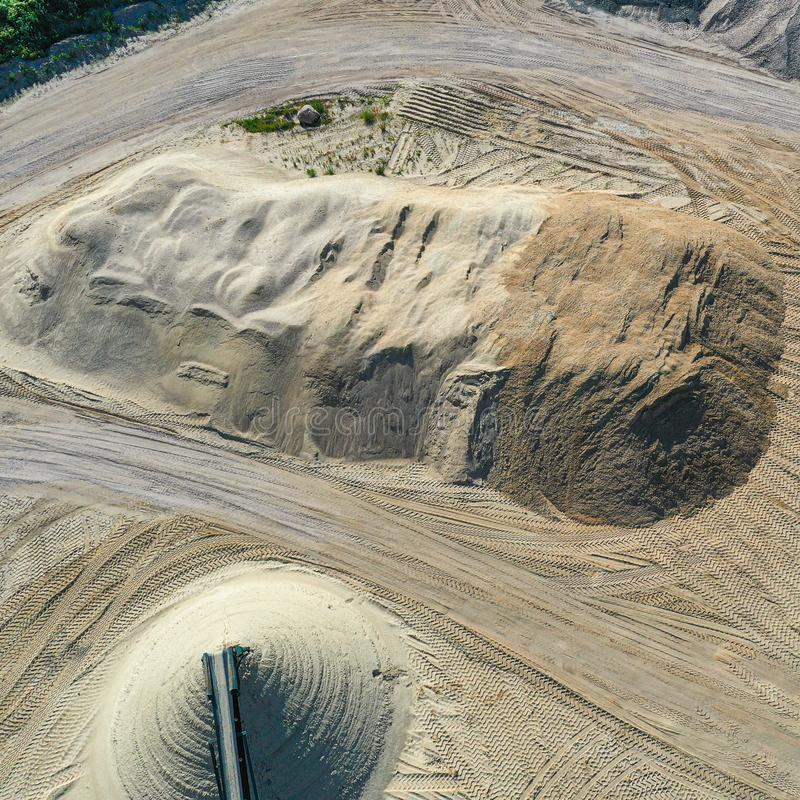 Aerial view of a large heap of sand in a gravel pit and sand pit, oblique photograph, drone shot. Aerial view of a large heap of sand in a gravel pit and sand stock images
