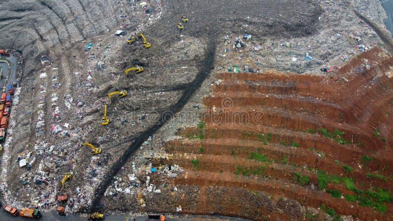 Aerial View. Large landfills like mountains. the tractor take garbage on landfills at Bekasi - Indonesia royalty free stock image