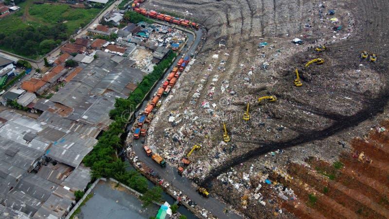 Aerial View. Large landfills like mountains. the tractor take garbage on landfills at Bekasi - Indonesia stock images