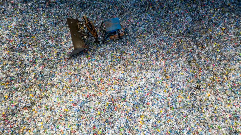 Aerial view large pile of waste plastic bottles in the factory to wait for recycle, Plastic Awareness, Plastic pollution royalty free stock images